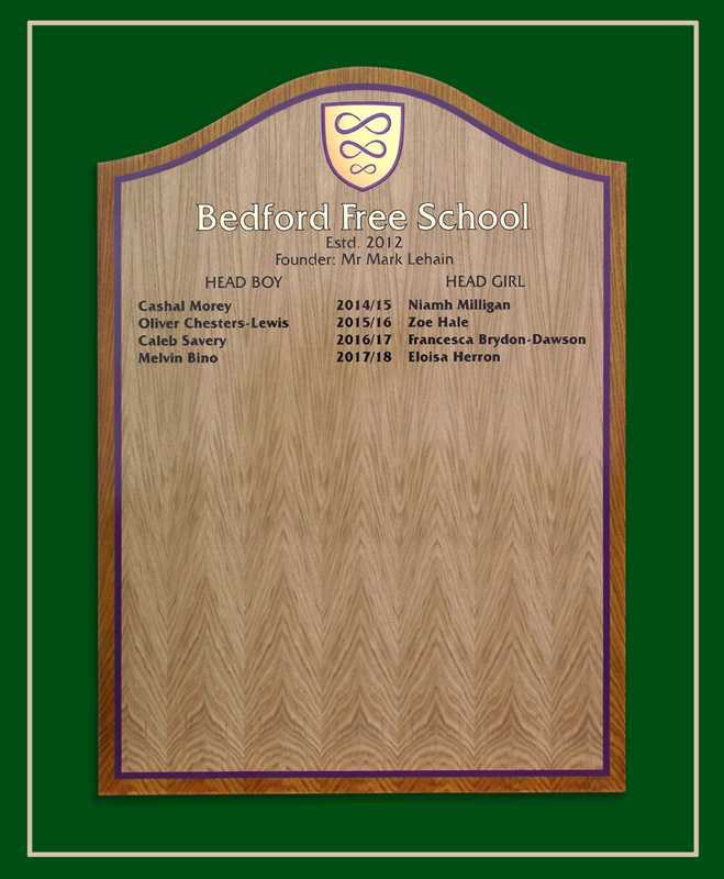 An light oak honours board in two shades of wood colour.
