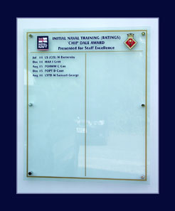 Winners names of Royal Navy training awards displayed on a Perspex honours board