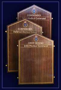 Three Oak honours boards naming the commanding officers of the Joint Medical Command.