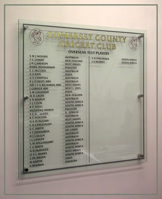 Perspex honours board displaying names of Somerset Cricket Club's Test players