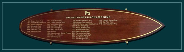 A champions names board in the shape of a life size surf board