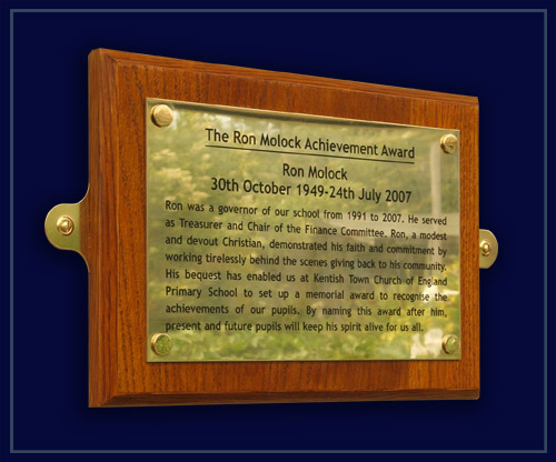 wood and brass memorial plaque