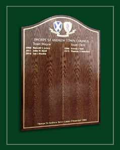 Oak honours board displaying the names of Thorpe Saint Andrew's Mayors and Town Clerks.