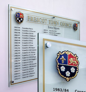 This image shows a Perspex, acrylic, honours board listing the names of Prescot Town Council Mayors.